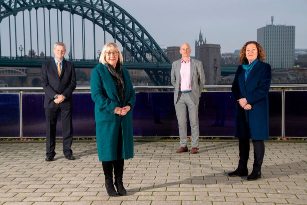 Chief Executives of Newcastle's public sector organisations standing in front of a bridge in Newcastle.